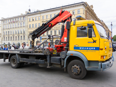 breaking the rules: ST PETERSBURG - MAY 29, 2011: A wrecker bus of the city traffic police stands in Nevsky Prospekt in the downtown. Its task is to arrest cars breaking parking rules.