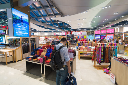 haberdashery: BANGKOK - MARCH 18; 2015: Unidentified people shop at duty free haberdashery boutiques at the International Airport Suvarnabhumi which is the sixth busiest airport in Asia.
