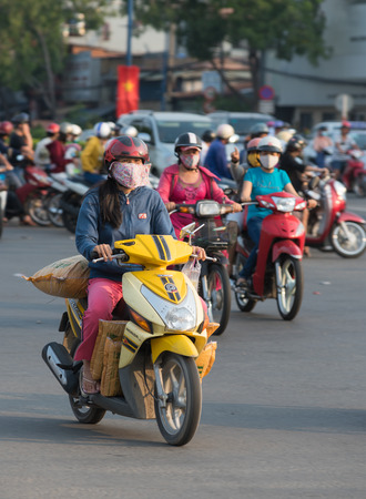 means of transportation: HOCHIMINH, VIETNAM - APRIL 19, 2015: An unidentified motorcyclist drives several sacks in Truong Chinh Street during rush hours. The main means of cargo transportation in Vietnam is motorcycle.