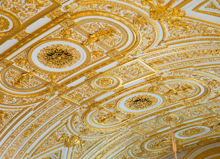 ST. PETERSBURG - JUNE 30, 2011: Gilt stucco ceiling in the Hermitage. One of the worlds largest and oldest museums, it was founded in 1764 by Catherine the Great and was open to the public in 1852.