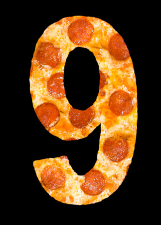 number 9 cut out of pizza with peperoni and cheese isolated photo