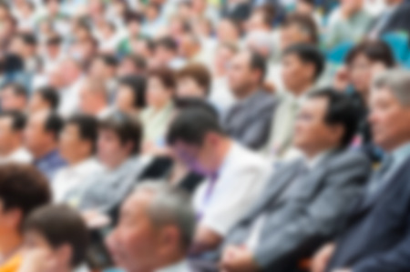 blurred audience at economical forum in hall 写真素材