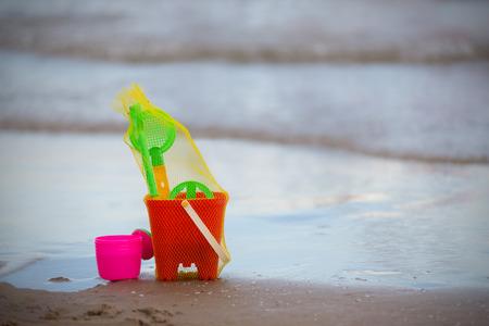 deserted: kids toys for sand box at deserted beach