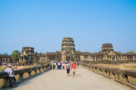 architectural heritage of the world: ANGKOR, CAMBODIA - FEB 20, 2013: A lot of tourists see round Angkor Wat. It is a part of the ancient Khmer temple complex Angkor, the main tourist attraction in Cambodia. Editorial