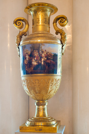 hermitage: ST PETERSBURG - JUNE 30, 2011: A golden vase with handles in one of halls of the Hermitage Museum. Today the collection of the museum contains about 3 million items.