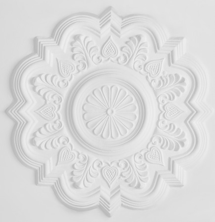 gypsum: floral stucco moulding rosette on white ceiling