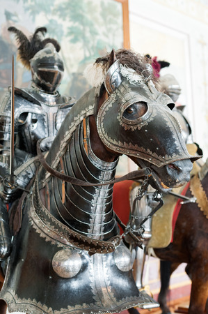 arsenał: ST. PETERSBURG - JUNE 30, 2011: One of knights mannequins on horses at Knights Hall of the Hermitage. It hosts a part of the Hermitage Arsenal collection.