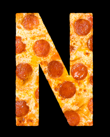 peperoni: letter N cut out of pizza with peperoni and cheese, isolated