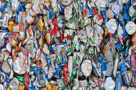 deformed: VUNG TAU, VIETNAM - AUGUST 28, 2015: A lot of empty beer cans deformed because of compression. Pollution and garbage utilization have become global problems of the earth. Editorial