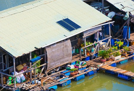 fish breeding: floating dwelling house with solar batteries at fish breeding farm, Vietnam Stock Photo
