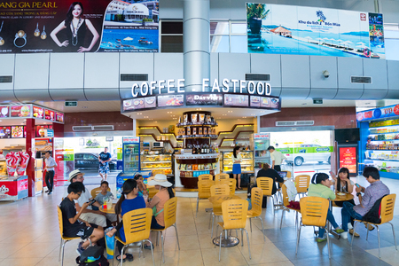 fast food restaurant: CAM RANH, VIETNAM - OCTOBER 8, 2015: Unidentified people dine at a fast food cafe at the Cam Ranh International Airport. It serves the city of Nha Trang which is 30 km of the airport. Editorial