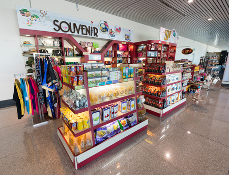 trifles: HO CHI MINH CITY, VIETNAM - DEC 15, 2015: A souvenir shop at the Tan Son Nhat International Airport. The airport serves the largest city of the country as well as the rest of southeastern Vietnam.