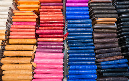 genuine good: many colorful leather wallets and purses for sale
