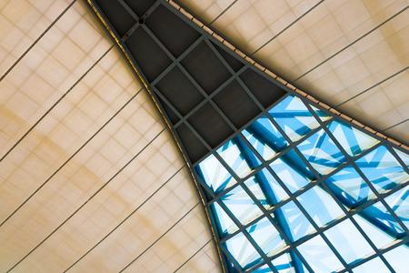 latticed: a geometrical latticed window in high ceiling Stock Photo