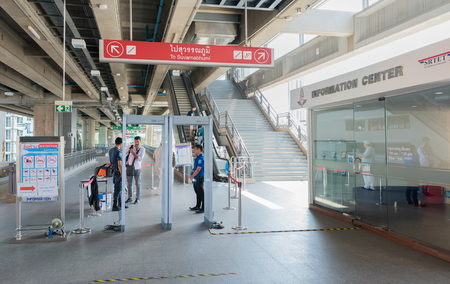 airport security: BANGKOK - DEC 17, 2015: Unidentified policemen work at a security check of Phaya Thai station. It is a rapid transit station of Airport Rail Link BTS Sukhumvit Line.