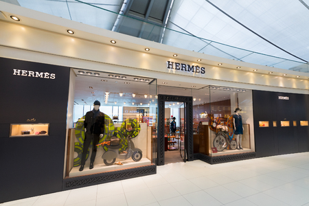 luxury goods: BANGKOK - DEC 17, 2015: A boutique of Hermes at the Airport Suvarnabhumi. Hermes is a French manufacturer specializing in leather, lifestyle accessories, perfumery, luxury goods, and ready to wear. Editorial