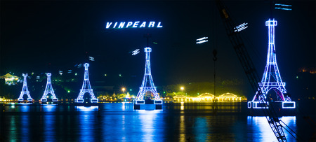 trang: NHA TRANG, VIETNAM - JANUARY 4, 2016: A night view at illuminated supports of cableway to Vinpearl, a large amusement park located on an island, the main place of interest in the city which is a popular sea resort.
