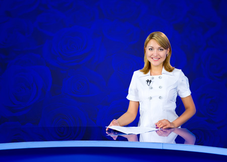 newsreader: television anchorwoman at blue studio with roses Stock Photo