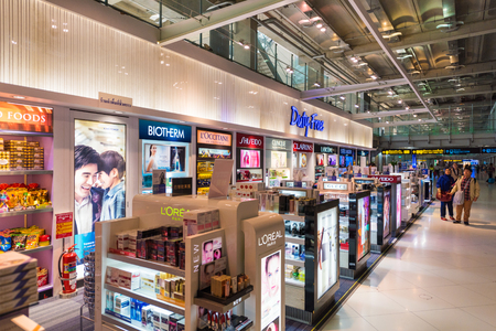 christmas perfume: BANGKOK - DEC 15, 2015: Duty free cosmetics boutiques at the International Airport Suvarnabhumi not long before Christmas. The airport is the sixth busiest airport in Asia. Editorial
