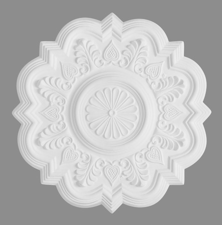 stucco: floral stucco moulding rosette on grey background Stock Photo