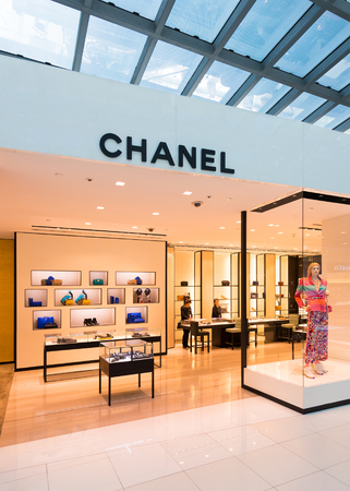 chanel: BANGKOK - DECEMBER 17, 2015: A boutique of Chanel in duty free area of the International Airport Suvarnabhumi. Chanel S.A. is a high fashion house founded in in Paris, 1909.