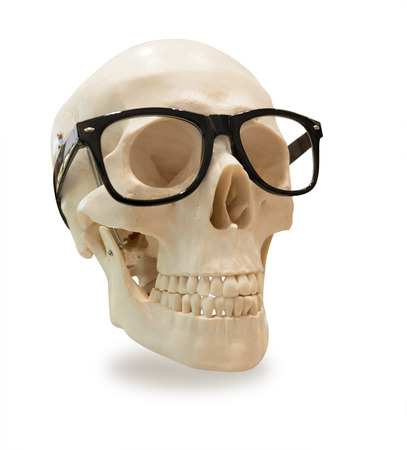 human skull in black glasses frame, isolated