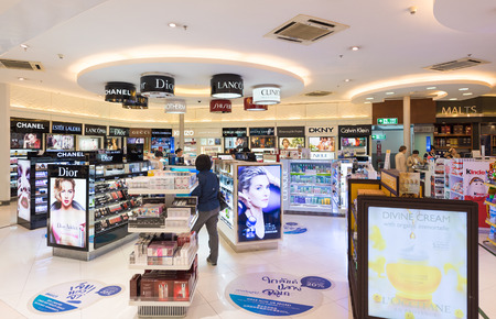 BANGKOK - DECEMBER 17; 2015: Unidentified people shop at duty free cosmetics boutiques at the International Airport Suvarnabhumi which is the sixth busiest airport in Asia.
