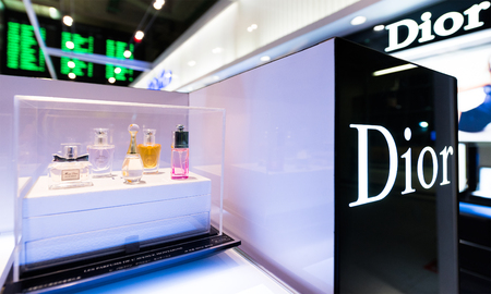 light duty: BANGKOK - MARCH 15; 2016: The Dior perfumes in a showcase at a duty free boutique at the International Airport Suvarnabhumi which is the sixth busiest airport in Asia. Editorial