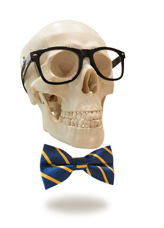human skull in black glasses frame and bow tie, isolated Banco de Imagens