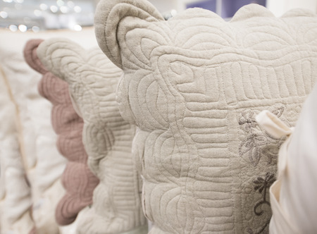 embroidered: new beige embroidered linen pillows, closeup shot