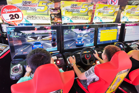 entertaining area: BANGKOK - MARCH 16, 2016: Unidentified teenagers play on game machines at the Hero city at the MBK Center, a large shopping mall. Bangkok is one of the worlds top tourist destination cities.