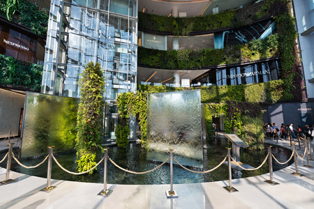 centres: BANGKOK - MARCH 17, 2016 : A view of the entrance hall of the Siam Paragon Shopping mall. It is one of the biggest shopping centres in Asia. Editorial
