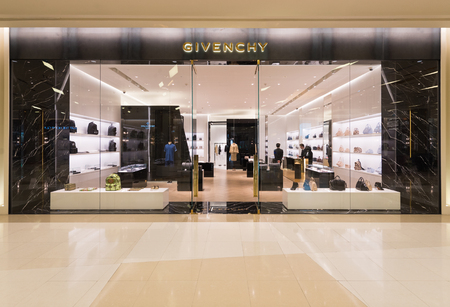 haute couture: BANGKOK - MARCH 17, 2016 : A Givenchy store in Siam Paragon Shopping mall. Givenchy is a luxury French brand of haute couture clothing, accessories and, as Parfums Givenchy, perfumes and cosmetics.