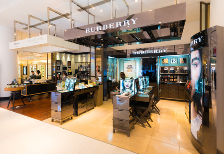 priced: BANGKOK - MARCH 17, 2016 : Unidentified sellers work at a Burberry store the Siam Paragon Shopping mall. Burberry, a British luxury fashion house, has more than 500 stores in over 50 countries.