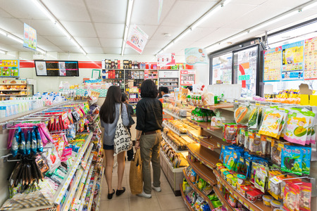 16 17: BANGKOK - MARCH 16, 2016 : Unidentified people buy goods at a 7-Eleven shop. 7-Eleven (7-11) is an international chain of convenience stores that operates some 58,300 stores in 17 countries. Editorial