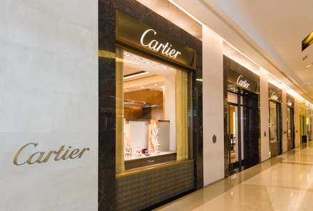 paragon: BANGKOK - MARCH 17, 2016 : A Cartier store in Siam Paragon Shopping mall. Cartier designs, manufactures, distributes and sells jewellery and watches. Founded in Paris, France in 1847. Editorial