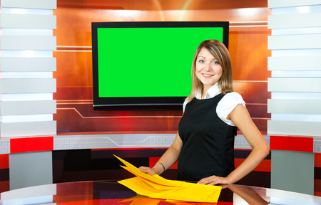 pregnant television anchorwoman at studio green screen chroma key photo