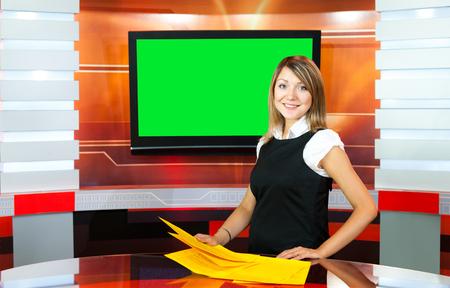 gravida: pregnant television anchorwoman at studio green screen chroma key