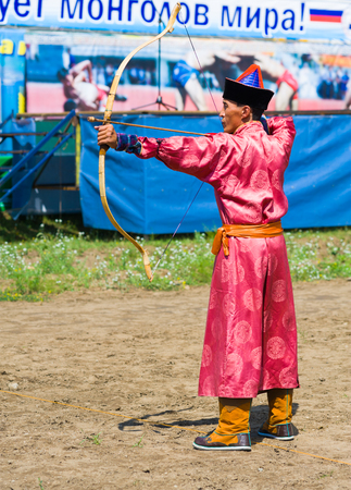 naadan: ULAN-UDE, RUSSIA - JULY 16, 2010: An unidentified archer takes part in Mongolian archery competition during the 4th General Session of the World Mongolians Convention. Editorial