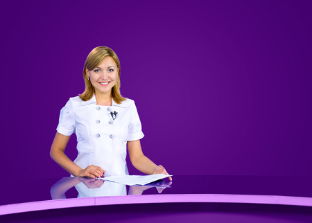 television anchorwoman at violet studio, live broadcasting photo