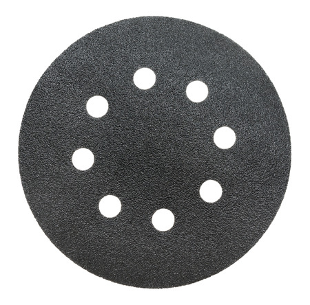 perforated: black perforated abrasive wheel, isolated over white