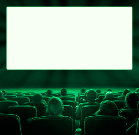 motion picture: viewers watch motion picture at movie theatre, long exposure