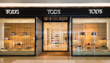 paragon: BANGKOK - MARCH 17, 2016 : A Tods store in Siam Paragon Shopping mall.  Tods Group is an Italian company which produces luxury shoes and other leather goods.