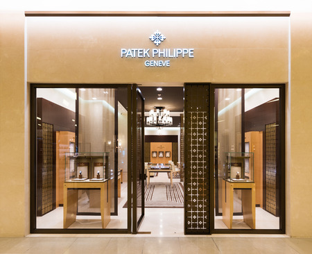 paragon: BANGKOK - MARCH 17, 2016: Patek Philippe store at the Siam Paragon mall. Patek Philippe is a Swiss watch manufacturer of timepieces and movements, including the most complicated mechanical watches.