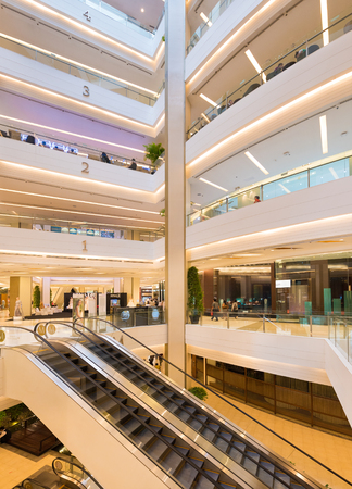 centres: BANGKOK - MARCH 17, 2016 : The interior of the Siam Paragon Shopping mall. It is one of the biggest shopping centres in Asia. Editorial