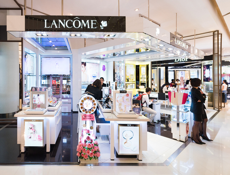 priced: BANGKOK - MARCH 17, 2016 : A Lancome store in Siam Paragon mall. Lancome is a French luxury perfumes and cosmetics house that distributes products internationally. Editorial