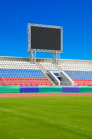 inoperative: scoreboard at empty outdoor stadium, switched off