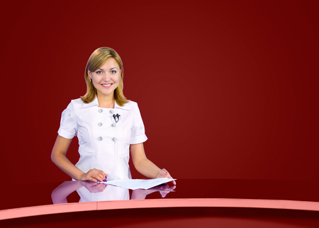 television anchorwoman at dark red studio, live broadcasting photo