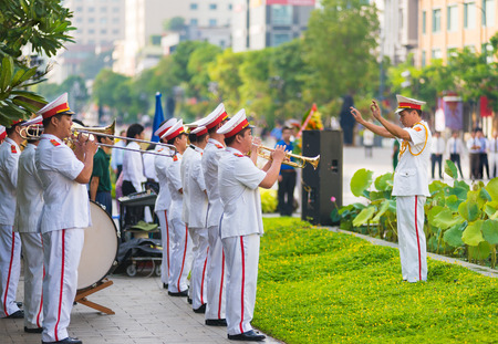 brass band: HO CHI MINH CITY, VIETNAM - MAY 19, 2016: A military band plays at the ceremony of bringing flowers to the Ho Chi Minhs monument on his birthday, an official public holiday.