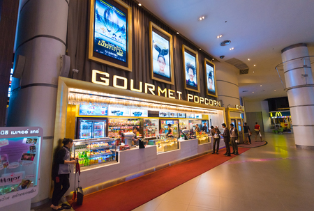 16 17: BANGKOK - MARCH 17, 2016 : Unidentified people buy food at a snack bar of Paragon Cineplex in the Siam Paragon shopping mall. With 16 screens and 5,000 seats, it is Thailands largest movie theater. Editorial